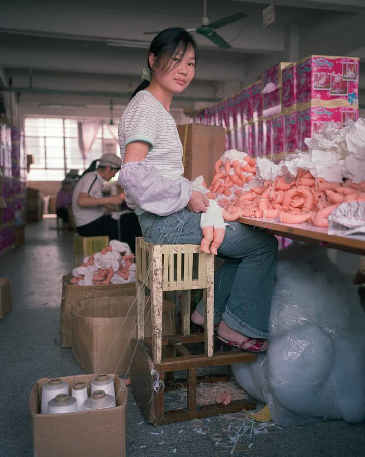 Toy factory worker on stools, China, Michael Wolf