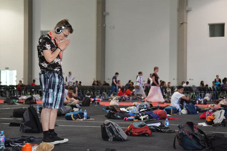 A pilgrim prays in the main hall at the Paradise in the City festival in Łódź. Photo: WYM