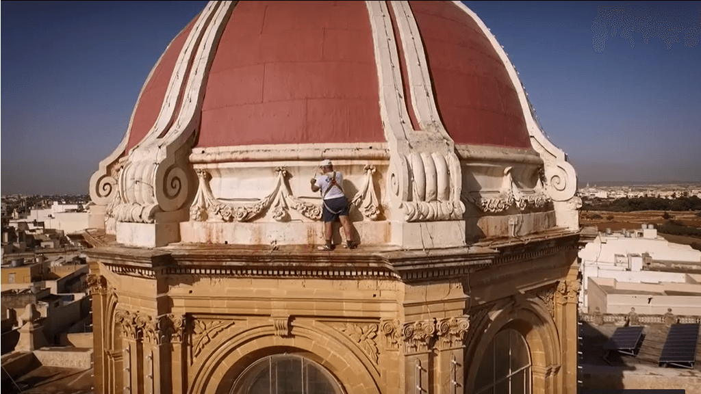 Volunteer on Church Dome before festa